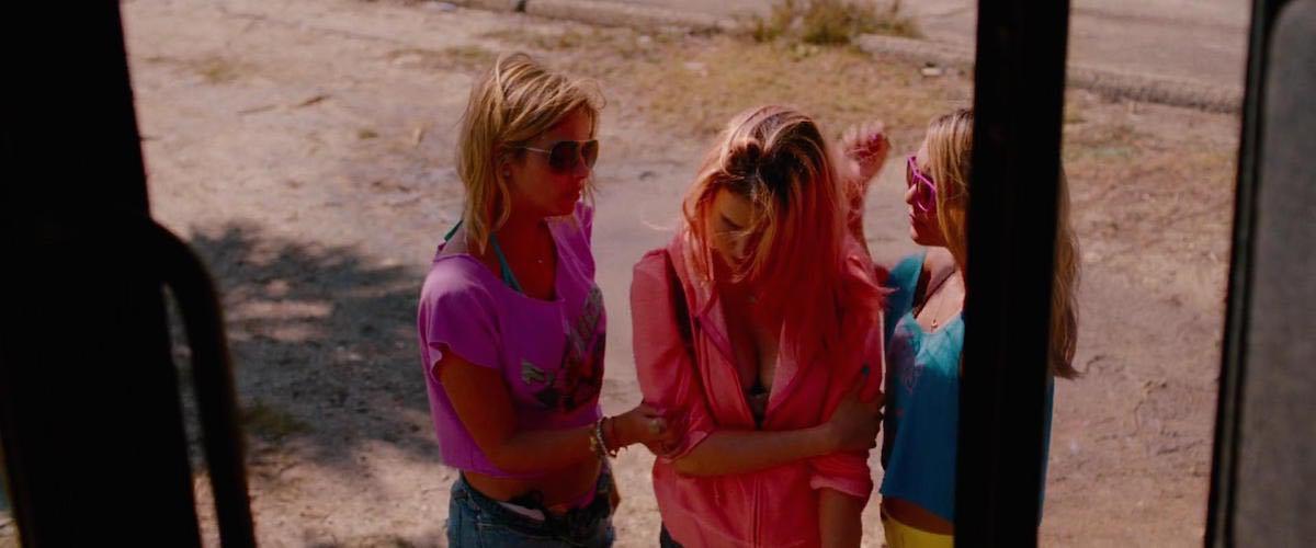 Cotty wears a Neon Pink American Apparel Hooded Jacket in Spring Breakers Scene