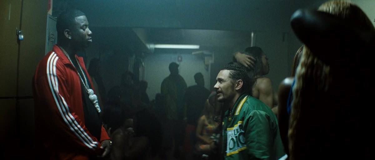 Spring Breakers Alien wears a Green SMOKIN SUPER CHRONIC Baseball Jacket when he argues with Archie in the Club