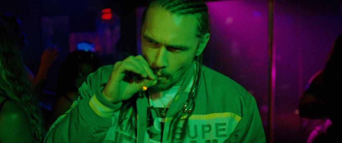 Spring Breakers Alien wears a Green SMOKIN SUPER CHRONIC Baseball Jacket