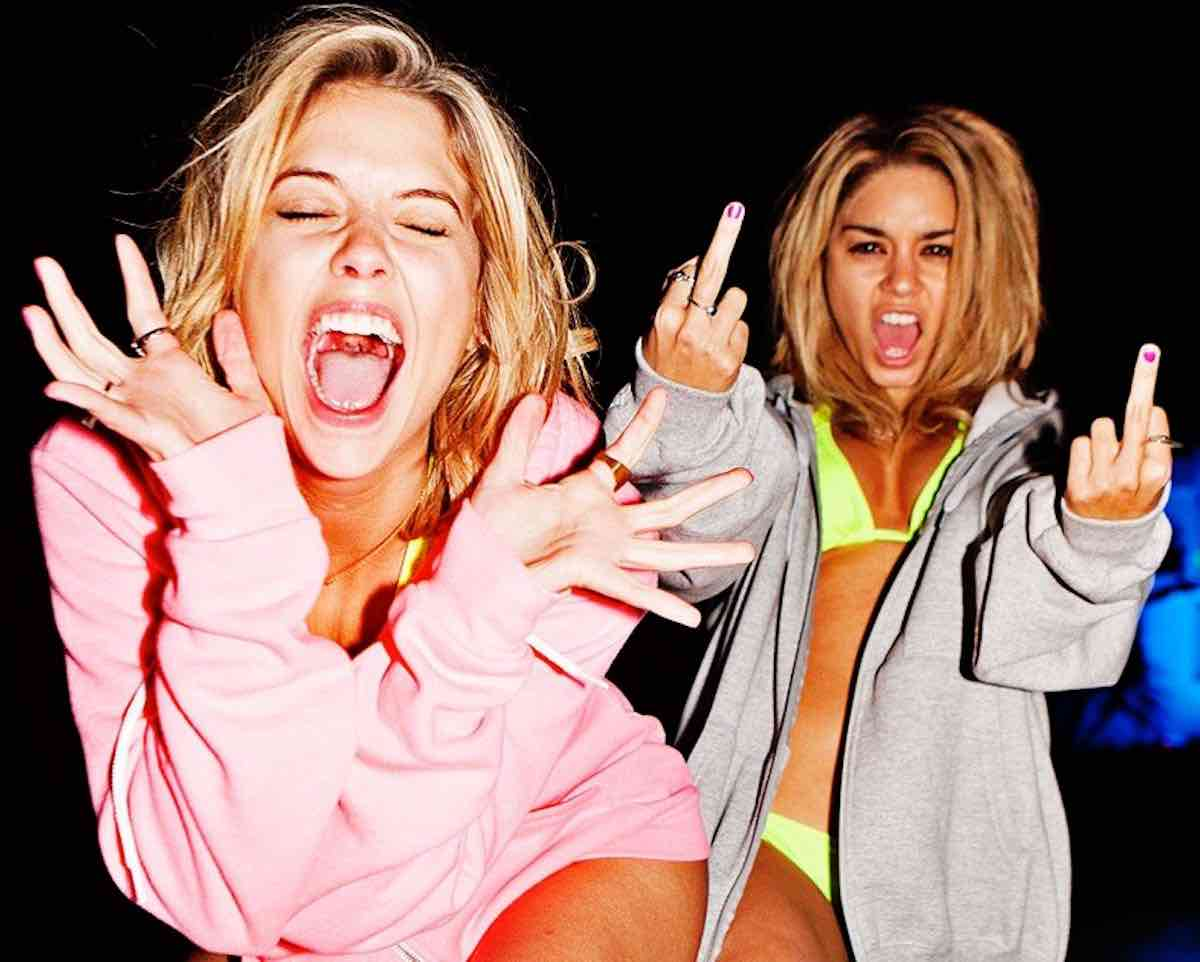 Candy wears her gray Champion hooded jacket in Spring Breakers and shows us her finger