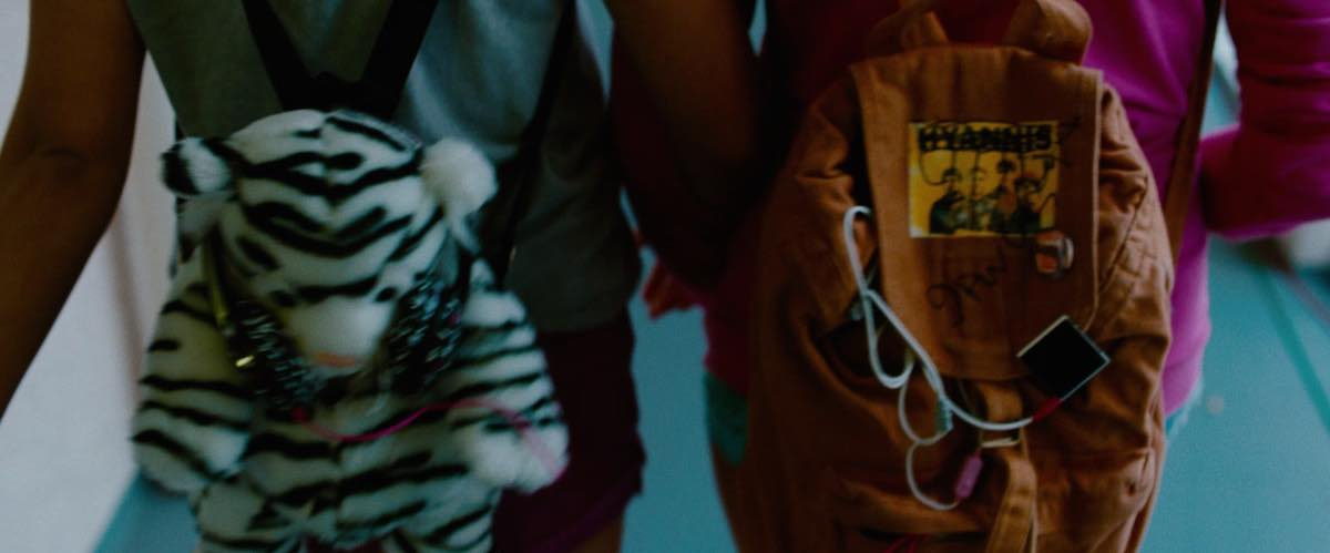 Candy wears her white baby tiger daypack in Spring Breakers