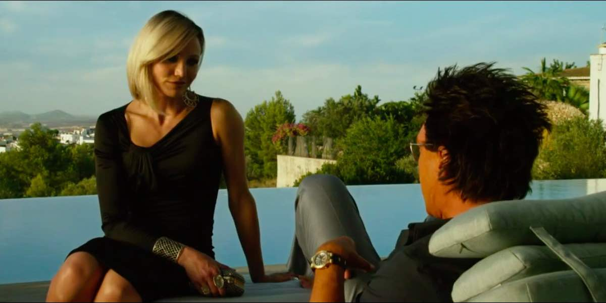 The Counselor Malinka wears a black one sleeve dress by Thomas Wylde on Reiner's sun lounger