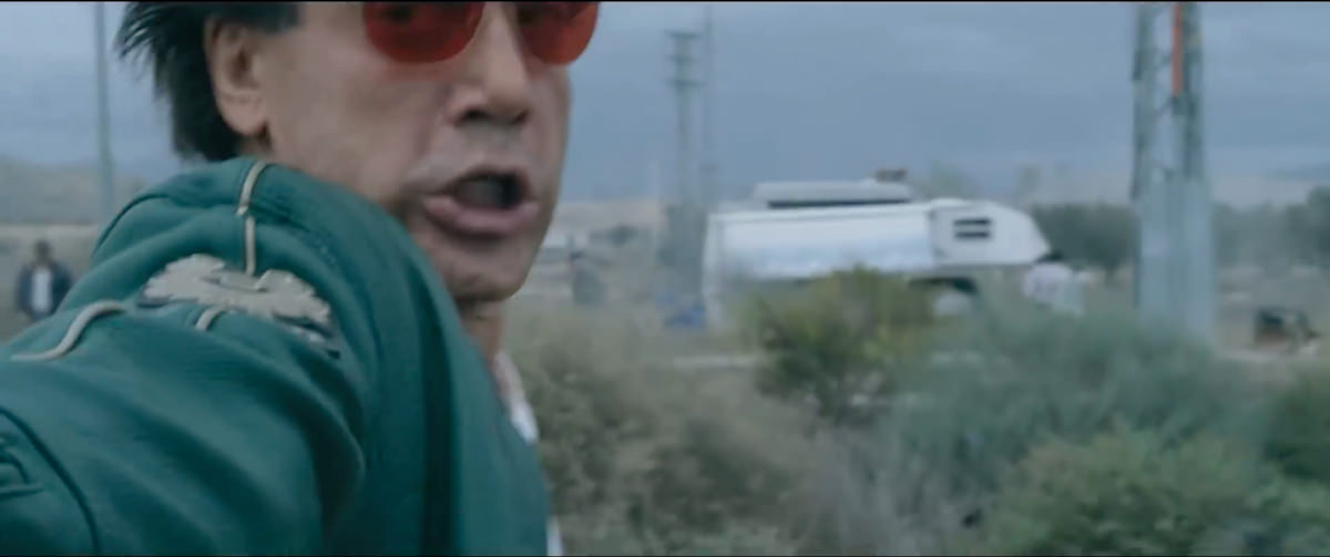 The Counselor Reiner wears the green Moto Leather Jacket Snetterton by Belstaff during the car chase and gunfight