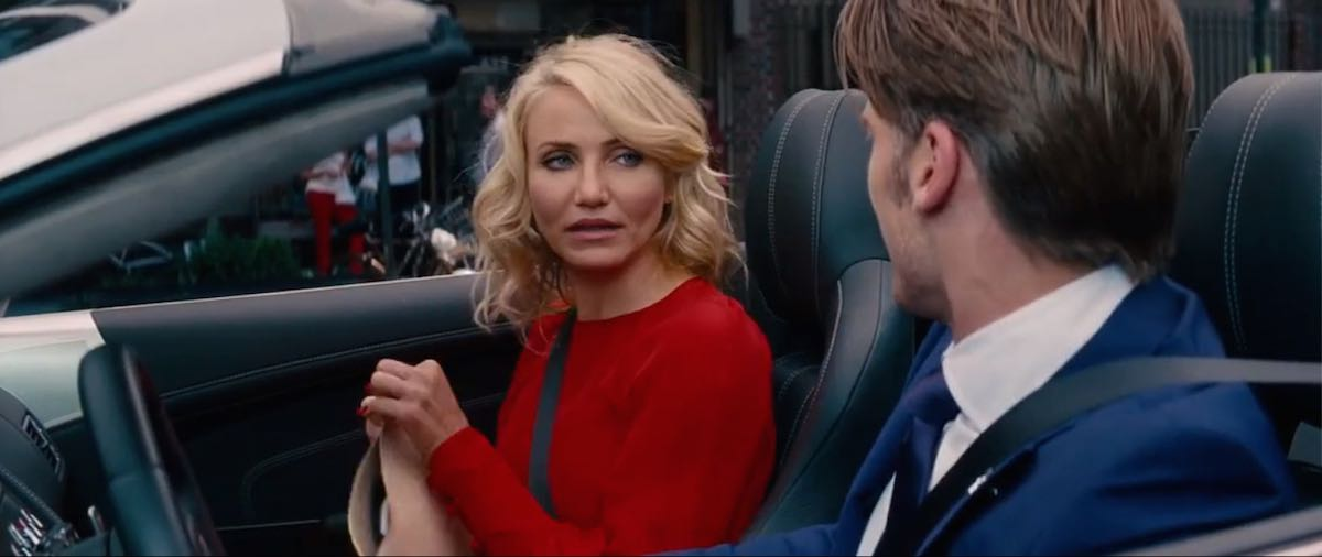 The Other Woman Carly wears a red long sleeve dress by Martin Grant in Mark's silver cabriolet