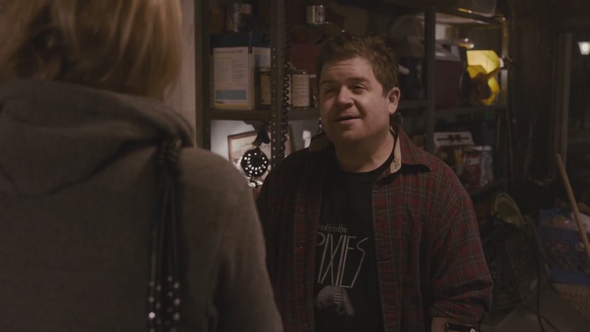 Young Adult - Matt Freehauf wears a black Pixies Album Death to the Pixies T-Shirt