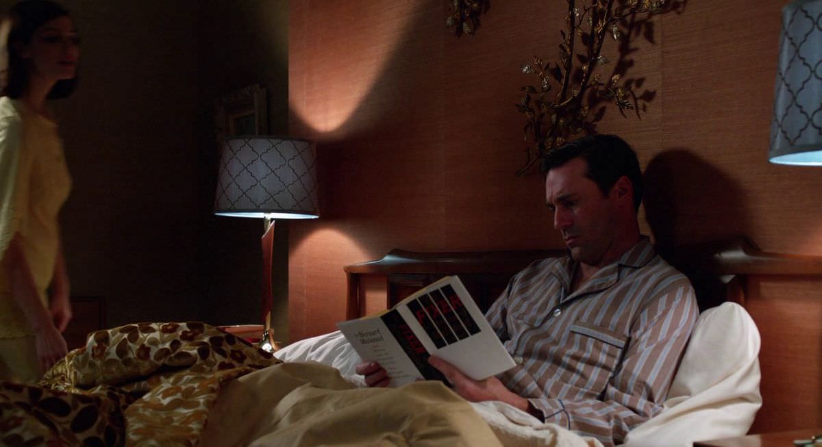 Mad Men Don Draper reads Bernard Malamud Book The Fixer in bed in the Episode At the Codfish Ball