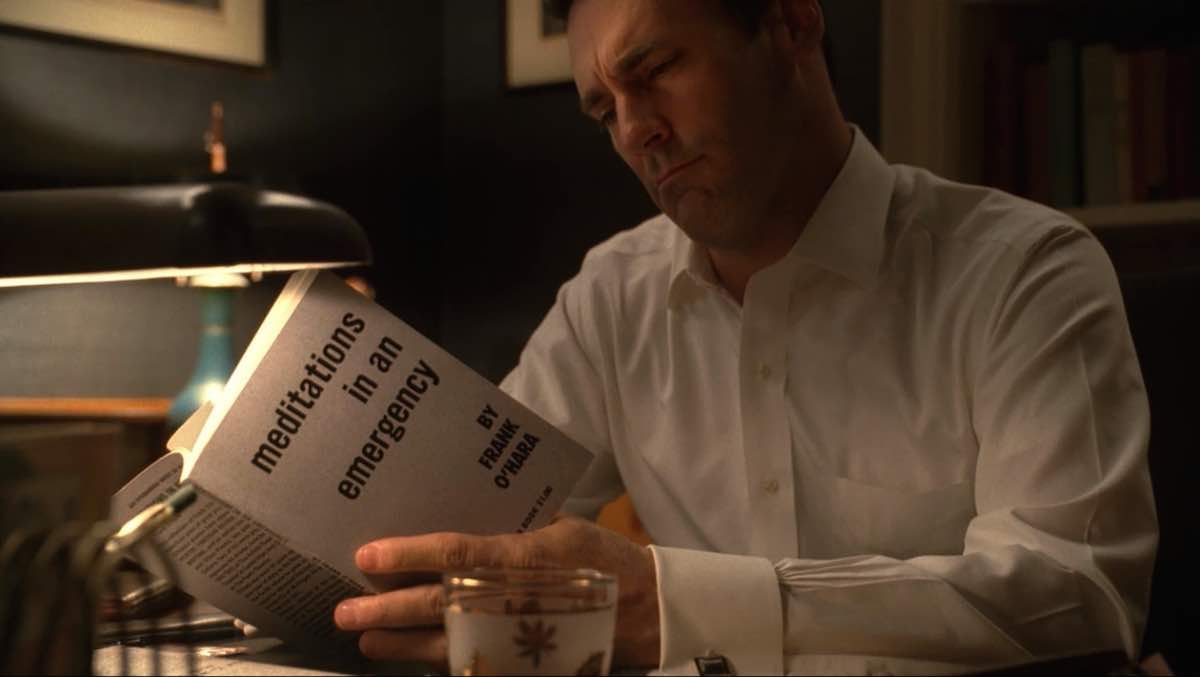 Mad Men Don Draper reads Frank O'Hara's Meditations in an Emergency book in For Those Who Think Young