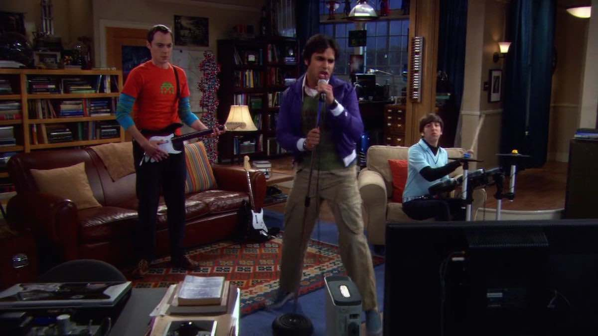The Big Bang Theory Sheldon Cooper plays Fender Stratocaster XBox e-guitar by MTV Games in his living room in The Maternal Capacitance