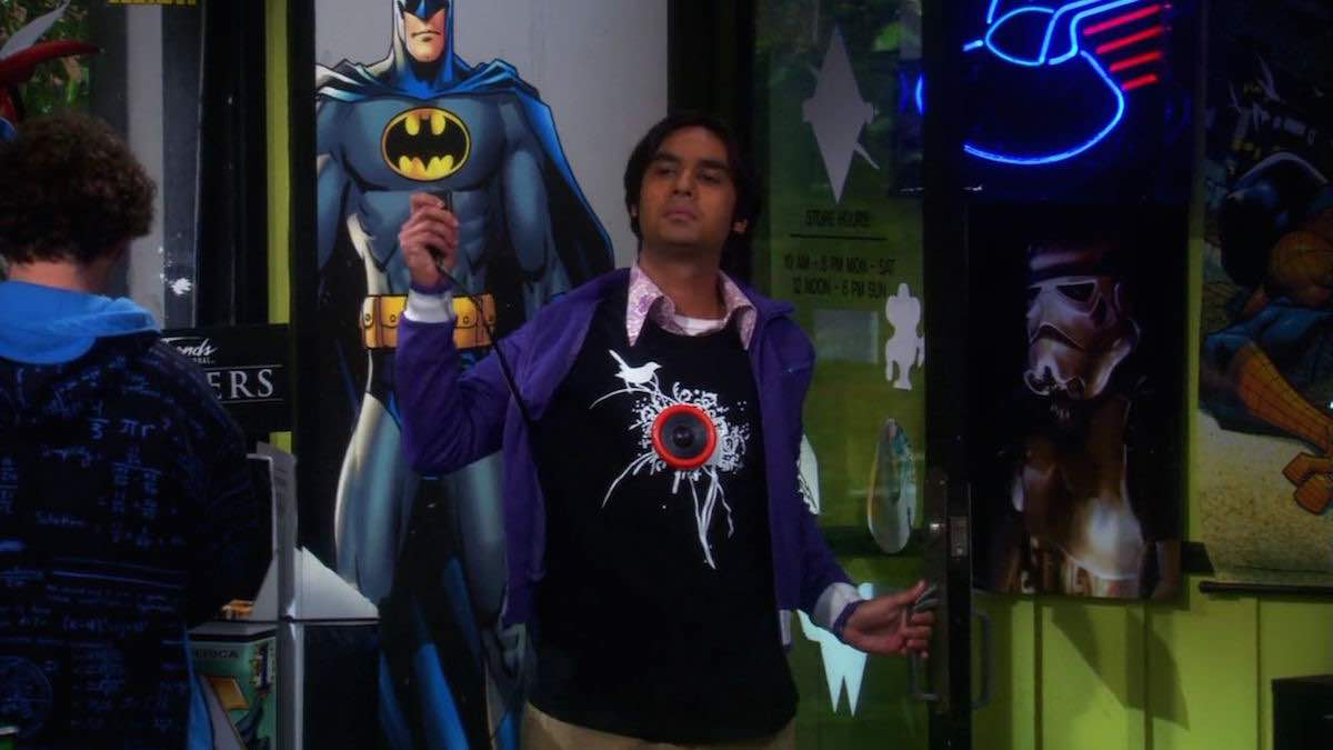 TBBT Raj wears black Personal Soundtrack T-Shirt in The Excelsior Acquisition